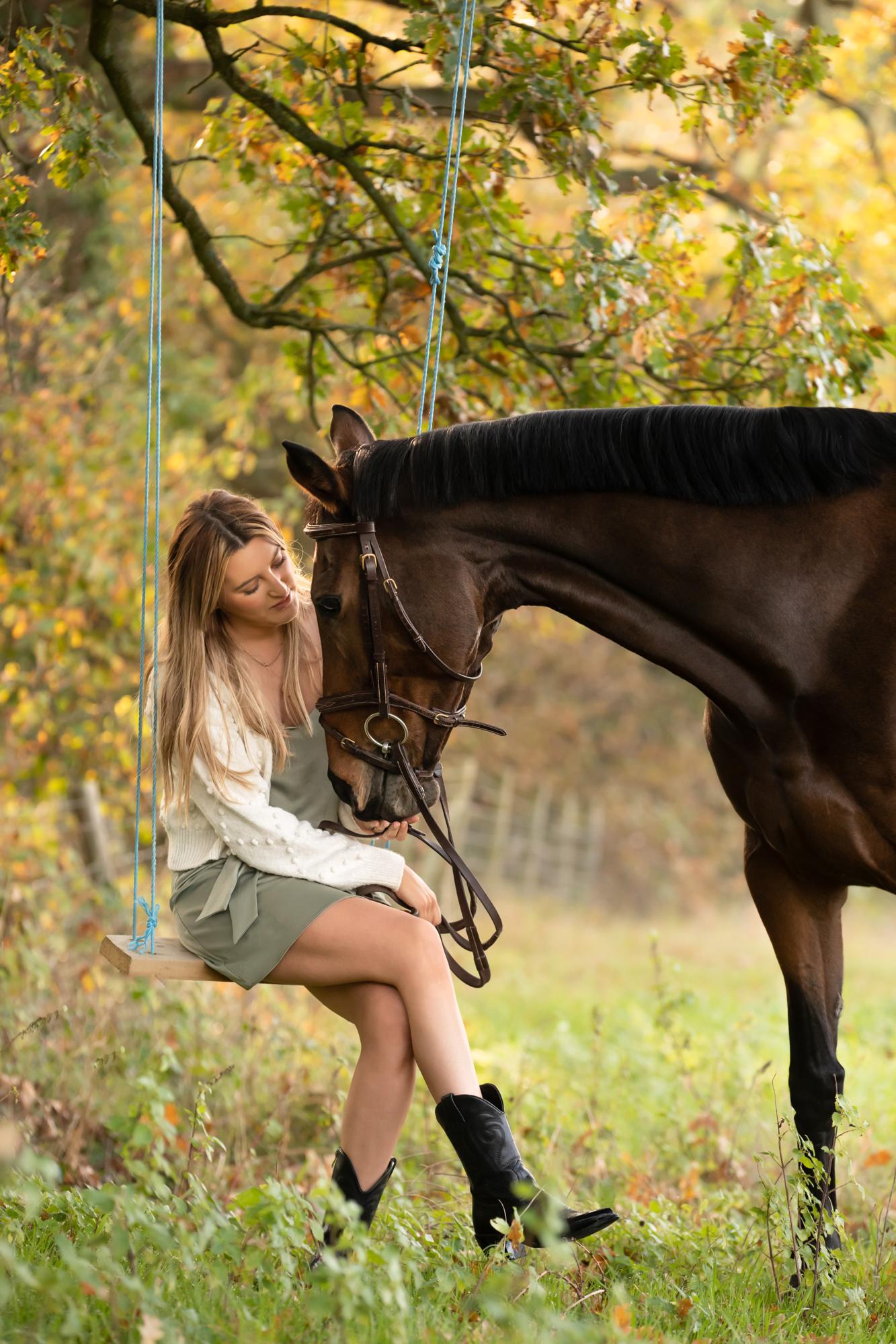 Autumn equine photoshoot girl on swing